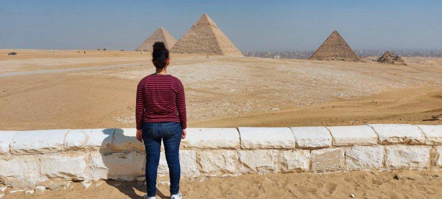 Girl looking at the Great Pyramids of Giza