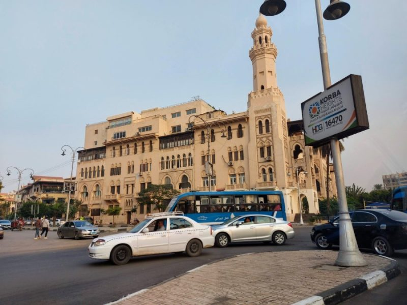 Cars and buses on a busy street in Cairo