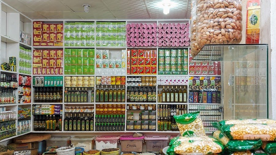 Local shop in the market selling products like spices, herbs, dates, nuts, etc.