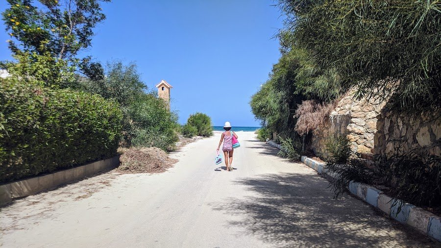 Girl walking to the beach in Marsa Matrouh